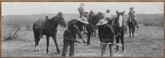 US Army soldiers and Scouts observe tracks before the Battle of Big Dry Wash in 1882.